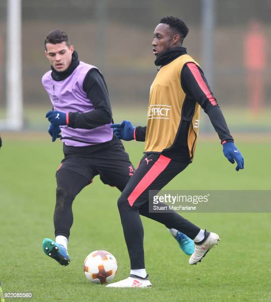 Granit Xhaka and Danny Welbeck of Arsenal during a training session at London Colney on February 21 2018 in St Albans England