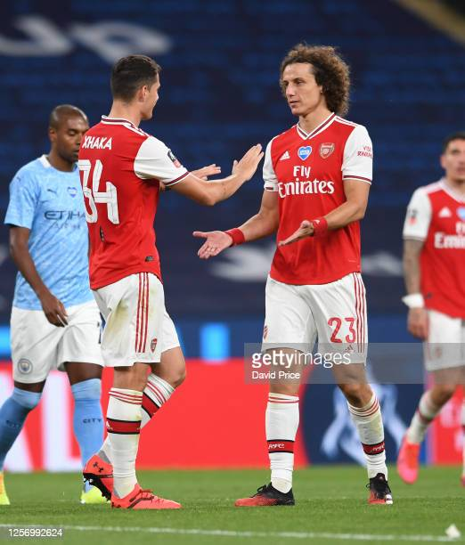 Granit Xhaka and David Luiz of Arsenal after the FA Cup Semi Final match between Arsenal and Manchester City at Wembley Stadium on July 18 2020 in...