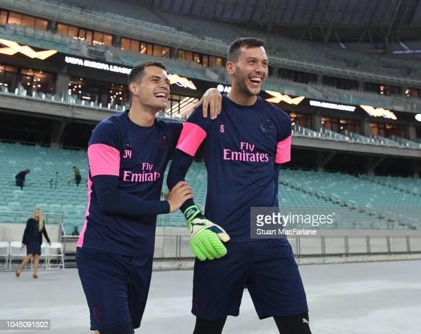 Granit Xhaka and Dejan Iliev of Arsenal before a training session at Baku Olimpiya Stadionu on October 3 2018 in Baku Azerbaijan
