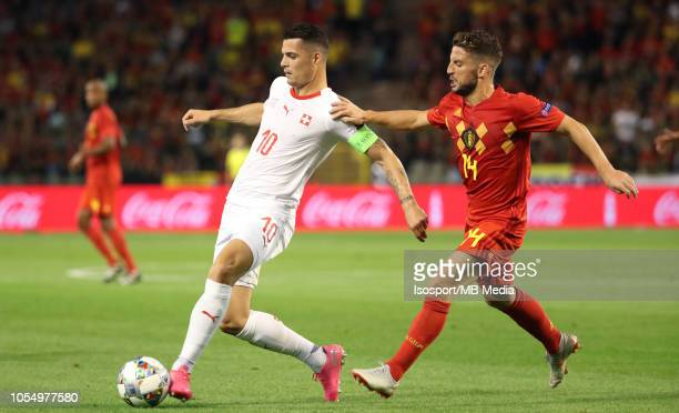 Granit Xhaka and Dries Mertens fight for the ball during the UEFA Nations League A group two match between Belgium and Switzerland at King Baudouin...