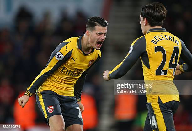 Granit Xhaka and Hector Bellerin of Arsenal celebrate after their team score to make it 33 during the Premier League match between AFC Bournemouth...