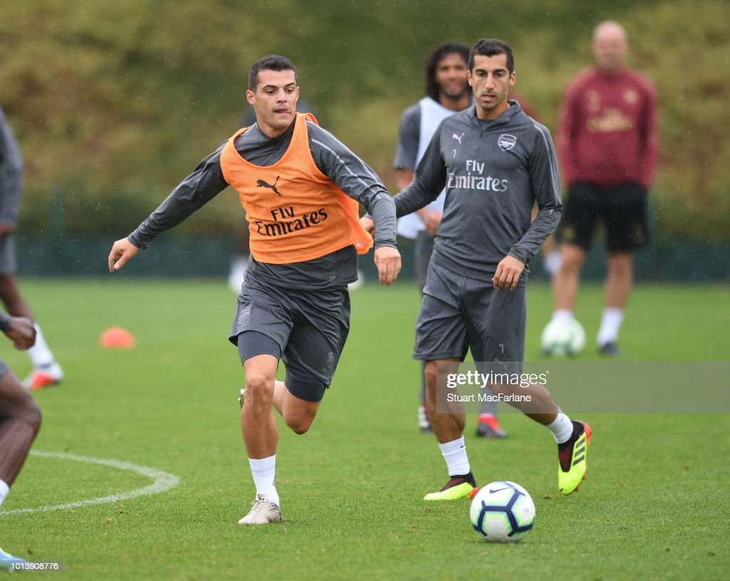 Granit Xhaka and Henrikh Mkhitaryan of Arsenal during a training session at London Colney on August 10, 2018 in St Albans, England.