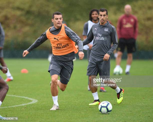 Granit Xhaka and Henrikh Mkhitaryan of Arsenal during a training session at London Colney on August 10 2018 in St Albans England