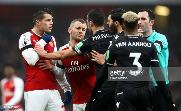 Granit Xhaka and Jack Wilshere of Arsenal clash with Luka Milivojevic and James Tomkins of Crystal Palace and during the Premier League match between...