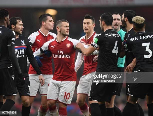 Granit Xhaka and Jak Wilshere clash with Patrick van Aanholt and Luka Milivojevic of Crystal Palace of Arsenal during the Premier League match...