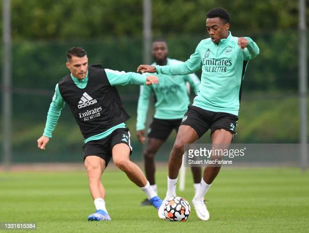 Granit Xhaka and Joe Willock of Arsenal during a training session at London Colney on July 30, 2021 in St Albans, England.