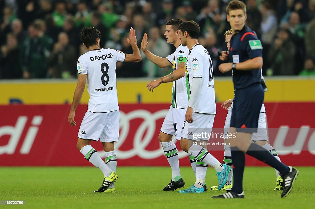 Granit Xhaka and Mahmoud Dahoud of Borussia Moenchengladbach celebrate after the second goal during the Bundesliga match between Borussia Moenchengladbach and FC Augsburg at Borussia-Park on September 23, 2015 in Moenchengladbach, Germany