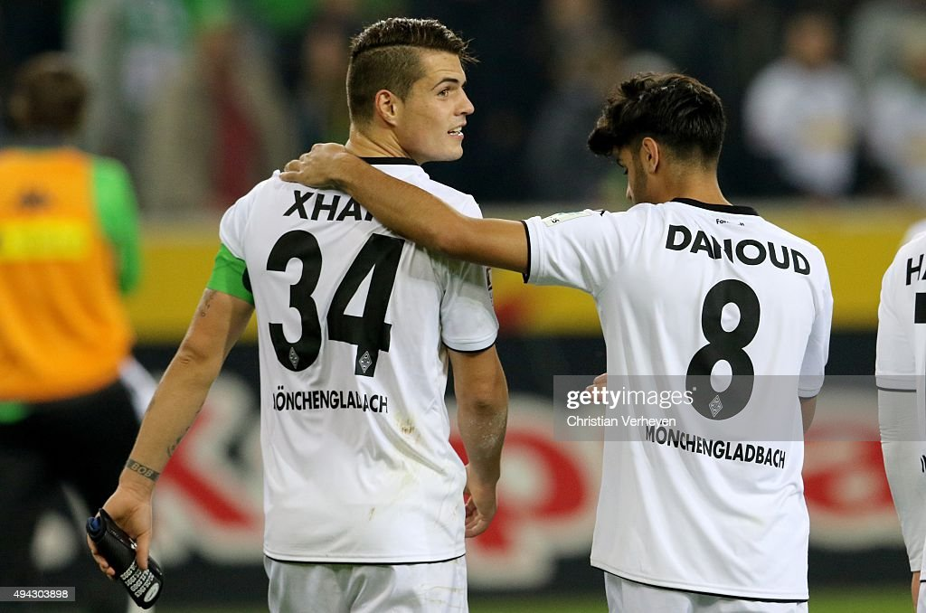 Granit Xhaka and Mahmoud Dahoud of Borussia Moenchengladbach after the Bundesliga match between Borussia Moenchengladbach and FC Schalke 04 at Borussia-Park on October 25, 2015 in Moenchengladbach, Germany