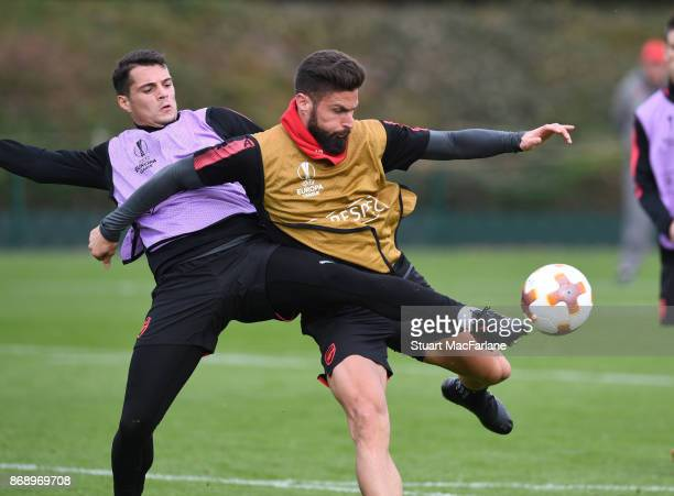 Granit Xhaka and Olivier Giroud of Arsenal during a training session at London Colney on November 1 2017 in St Albans England