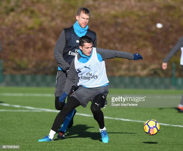 Granit Xhaka and Per Mertesacker of Arsenal during a training session at London Colney on January 19 2018 in St Albans England