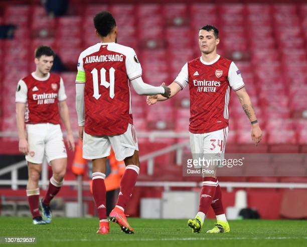 Granit Xhaka and Pierre-Emerick Aubameyang of Arsenal after the UEFA Europa League Round of 16 Second Leg match between Arsenal and Olympiacos at...