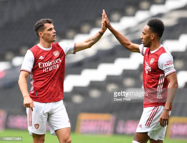 Granit Xhaka and PierreEmerick Aubameyang of Arsenal during the pre season friendly match between MK Dons and Arsenal at Stadium mk on August 25 2020...
