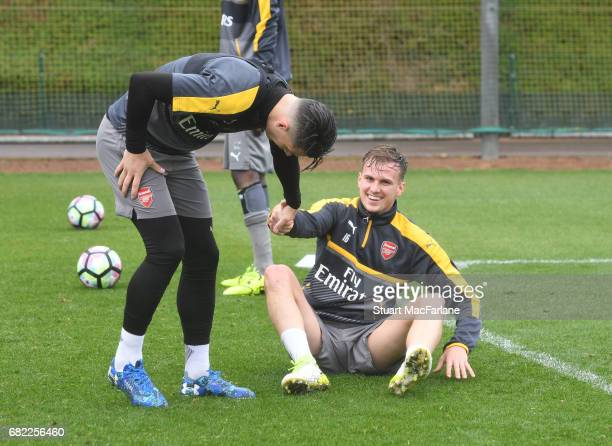 Granit Xhaka and Rob Holding of Arsenal during a training session at London Colney on May 12 2017 in St Albans England