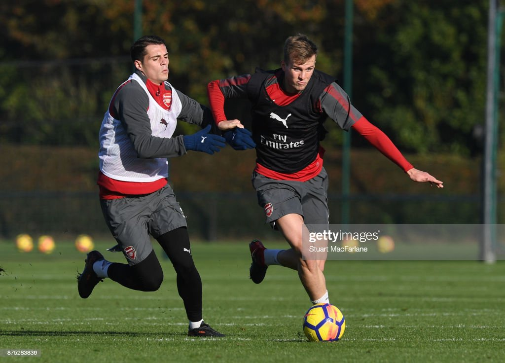 Granit Xhaka and Rob Holding of Arsenal during a training session at London Colney on November 17, 2017 in St Albans, England.