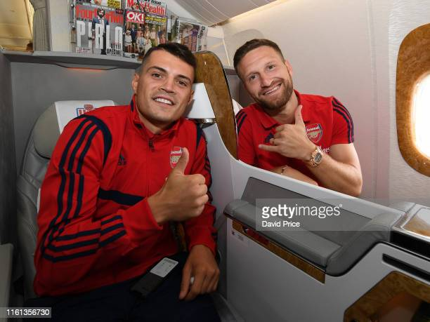 Granit Xhaka and Shkodran Mustafi of Arsenal on the plane at at Stansted Airport on July 11 2019 in Stansted Essex