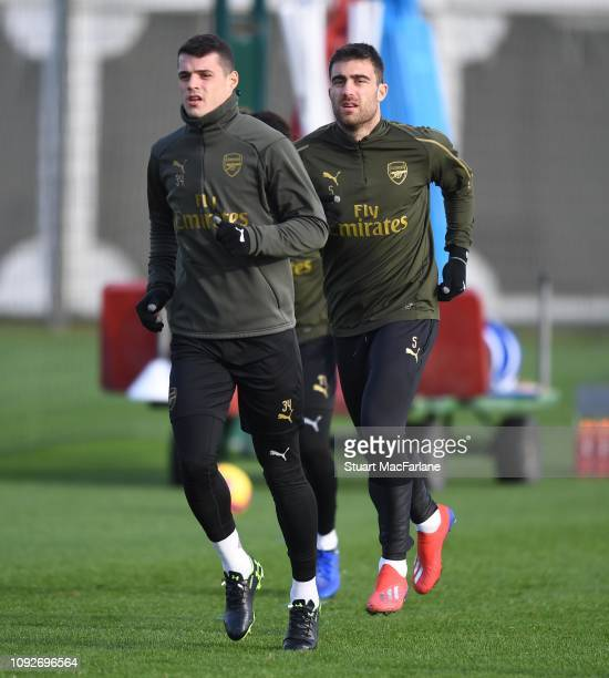 Granit Xhaka and Sokratis of Arsenal during a training session at London Colney on January 11 2019 in St Albans England