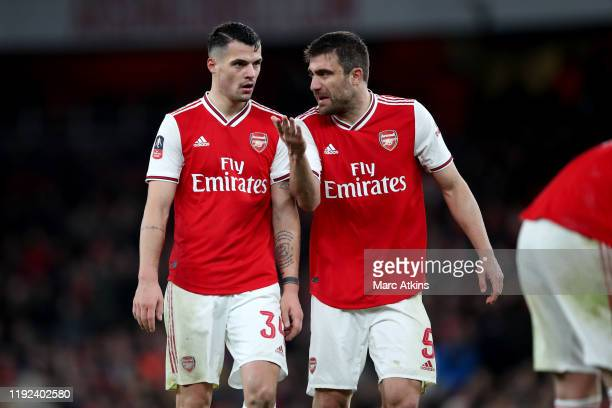 Granit Xhaka and Sokratis Papastathopoulos of Arsenal during the FA Cup Third Round match between Arsenal and Leeds United at Emirates Stadium on...