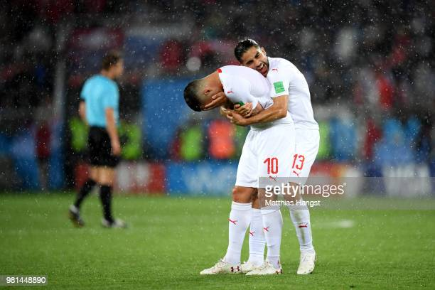 Granit Xhaka and teammmte Ricardo Rodriguez of Switzerland celebrate victory folowing the 2018 FIFA World Cup Russia group E match between Serbia and...