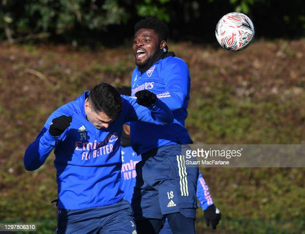Granit Xhaka and Thomas Partey of Arsenal during a training session at London Colney on January 22, 2021 in St Albans, England.