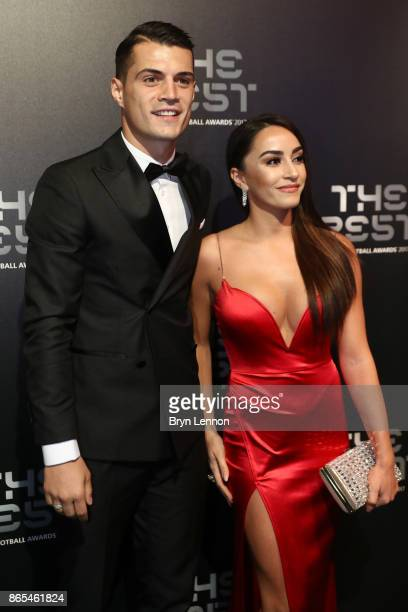 Granit Xhaka and wife Leonita Lekaj arrive for The Best FIFA Football Awards Green Carpet Arrivals on October 23 2017 in London England