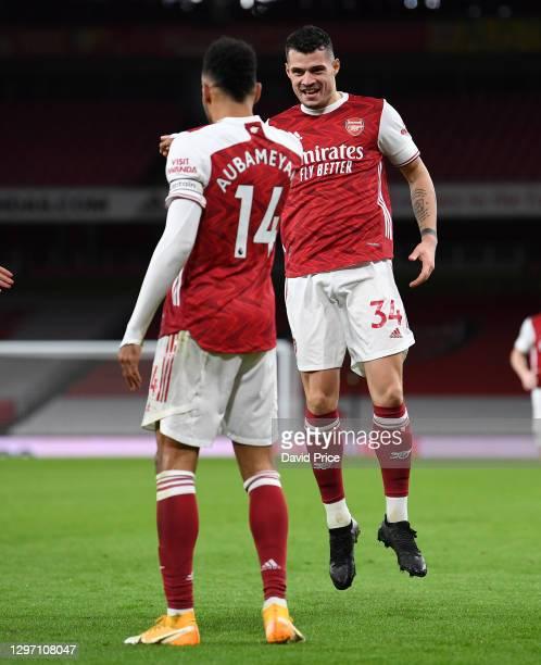 Granit Xhaka celebrates Arsenal's 1st goal with goalscorer Pierre-Emerick Aubameyang during the Premier League match between Arsenal and Newcastle...