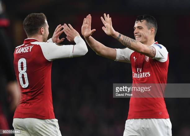 Granit Xhaka celebrates scoring Arsenal's 2nd goal with Aaron Ramsey during the match between Arsenal and AC Milan at Emirates Stadium on March 15...