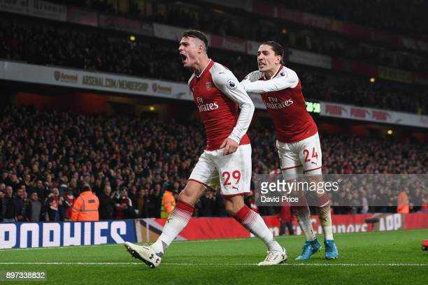 Granit Xhaka celebrates scoring Arsenal's 2nd goal with Hector Bellerin during the Premier League match between Arsenal and Liverpool at Emirates...