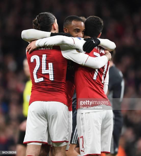 Granit Xhaka celebrates scoring the 2nd Arsenal goal with Hector Bellerin and Henrikh Mkhitaryan during the UEFA Europa League quarter final leg one...