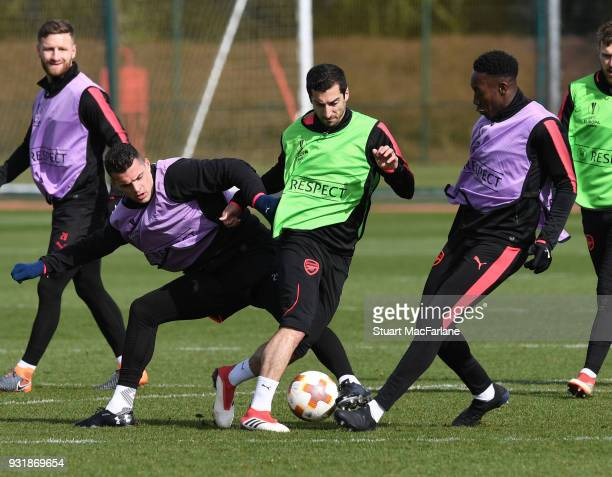 Granit Xhaka Henrikh Mkhitaryan and Danny Welbeck of Arsenal during a training session at London Colney on March 14 2018 in St Albans England