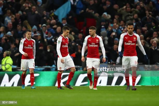 Granit Xhaka Laurent Koscielny Aaron Ramsey and PierreEmerick Aubameyang of Arsenal look dejected during the Carabao Cup Final between Arsenal and...