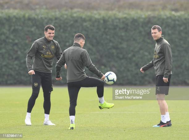 Granit Xhaka Lucas Torreira and Stephan Lichtsteiner of Arsenal during a training session at London Colney on March 01 2019 in St Albans England