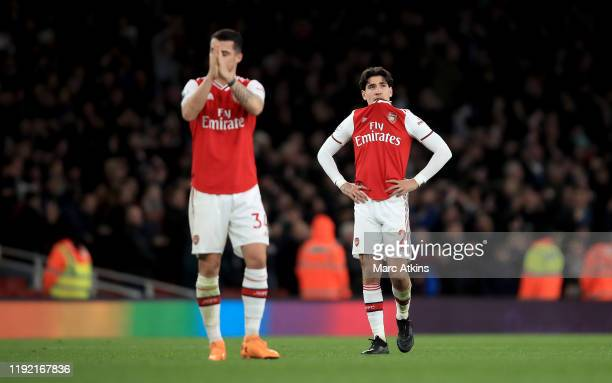 Granit Xhaka of Arsenal and Hector Bellerin of Arsenal look dejected after loosing the Premier League match between Arsenal FC and Brighton Hove...