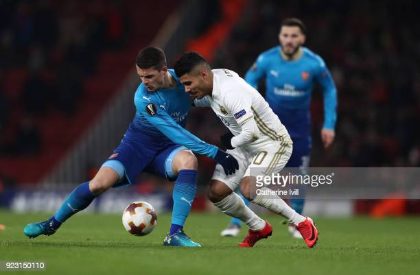 Granit Xhaka of Arsenal and Hosam Aiesh of Ostersunds FK during UEFA Europa League Round of 32 match between Arsenal and Ostersunds FK at the...