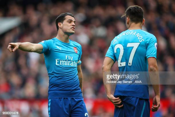 Granit Xhaka of Arsenal and Konstantinos Mavropanos of Arsenal during the Premier League match between Manchester United and Arsenal at Old Trafford...