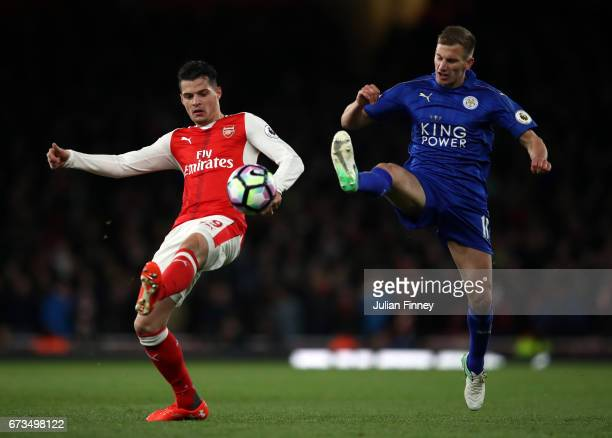 Granit Xhaka of Arsenal and Marc Albrighton of Leicester City clash during the Premier League match between Arsenal and Leicester City at the...