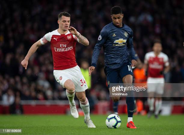 Granit Xhaka of Arsenal and Marcus Rashford of Manchester United during the Premier League match between Arsenal FC and Manchester United at Emirates...