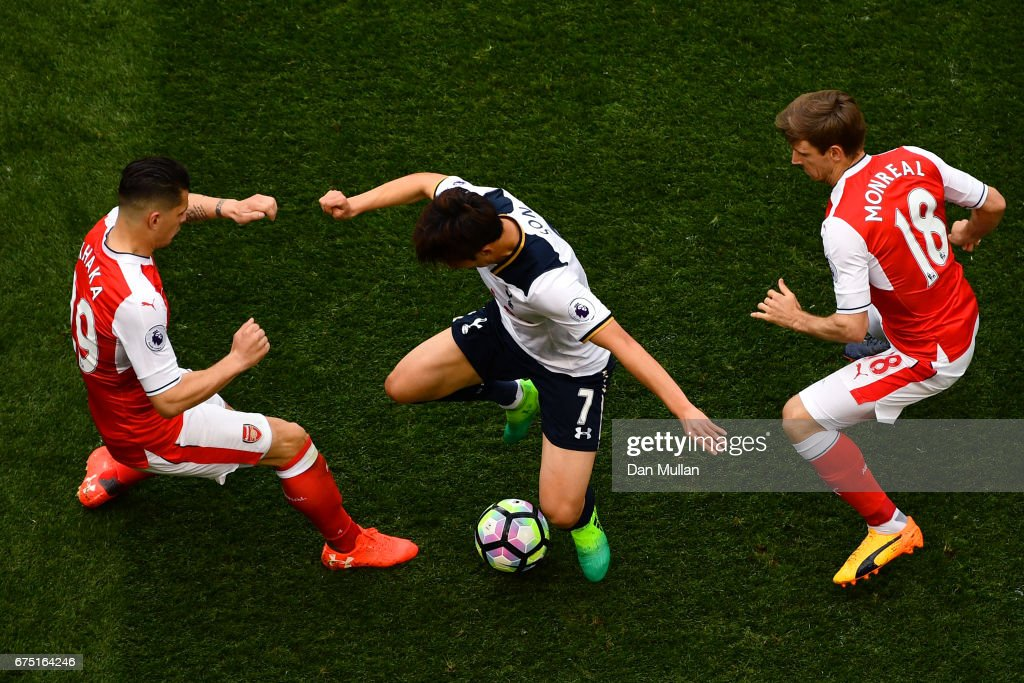 Granit Xhaka of Arsenal and Nacho Monreal of Arsenal attempt to tackle Heung-Min Son of Tottenham Hotspur during the Premier League match between Tottenham Hotspur and Arsenal at White Hart Lane on April 30, 2017 in London, England.