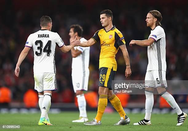 Granit Xhaka of Arsenal and Taulant Xhaka of Basel shake hands at the end of the UEFA Champions League group A match between Arsenal FC and FC Basel...