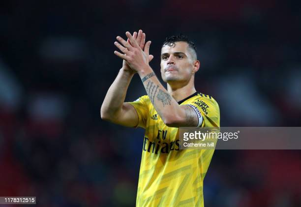 Granit Xhaka of Arsenal applauds after the Premier League match between Manchester United and Arsenal FC at Old Trafford on September 30, 2019 in...