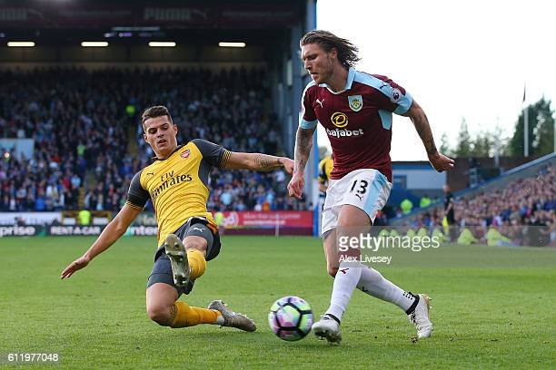 Granit Xhaka of Arsenal attempts to stop Jeff Hendrick of Burnley from going through on goal during the Premier League match between Burnley and...