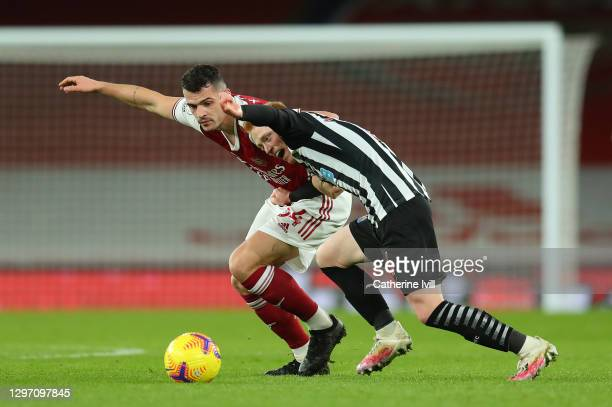 Granit Xhaka of Arsenal battles for possession with Matty Longstaff of Newcastle United during the Premier League match between Arsenal and Newcastle...