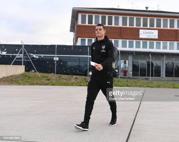 Granit Xhaka of Arsenal boards the team flight at Luton Airport on October 3 2018 in Luton England