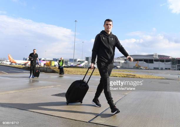 Granit Xhaka of Arsenal boards the team flight to Milan at Luton Airport on March 7 2018 in Luton England