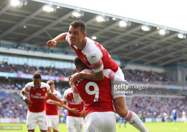 Granit Xhaka of Arsenal celebrates after PierreEmerick Aubameyang of Arsenal scores his sides second goal during the Premier League match between...