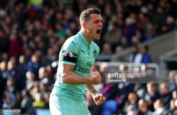 Granit Xhaka of Arsenal celebrates after PierreEmerick Aubameyang of Arsenal scores their side's second goal during the Premier League match between...
