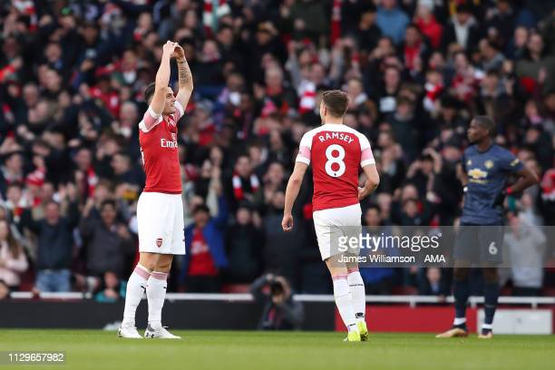 Granit Xhaka of Arsenal celebrates after scoring a goal to make it 10 during the Premier League match between Arsenal FC and Manchester United at...