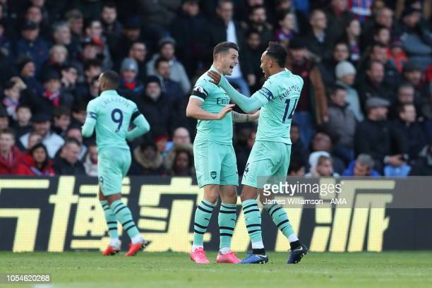 Granit Xhaka of Arsenal celebrates after scoring a goal to make it 11 with PierreEmerick Aubameyang of Arsenal during the Premier League match...
