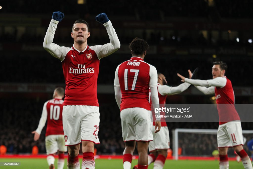 Granit Xhaka of Arsenal celebrates after scoring a goal to make it 2-1 during the Carabao Cup Semi-Final Second Leg match between Arsenal and Chelsea at The Emirates Stadium on January 24, 2018 in London, England.