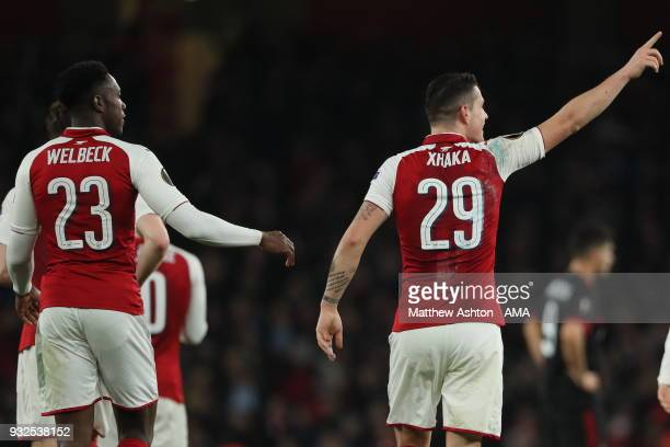 Granit Xhaka of Arsenal celebrates after scoring a goal to make it 21 during the UEFA Europa League Round of 16 Second Leg match between Arsenal and...