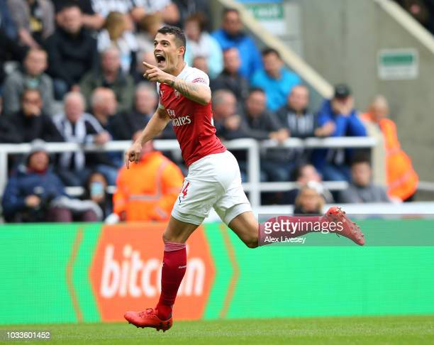 Granit Xhaka of Arsenal celebrates after scoring his team's first goal during the Premier League match between Newcastle United and Arsenal FC at St...